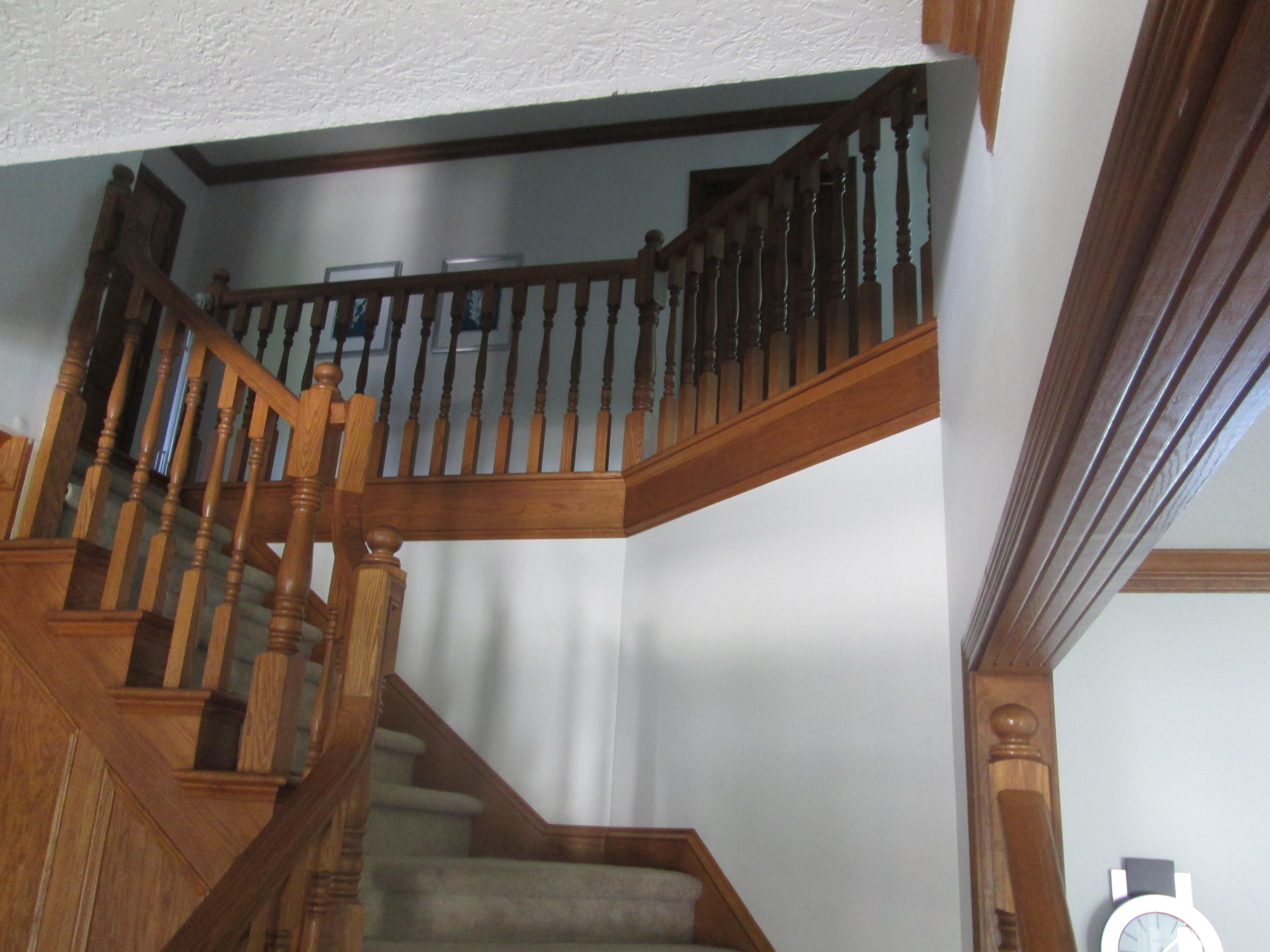 Guy Painting Wood Stairs
